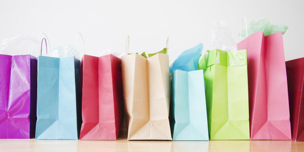 Colorful shopping bags standing in row
